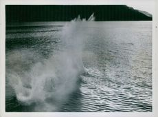 The splash caused by the torpedo enduring the water.