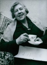 Mrs. Mirabel Topham having a cup of tea. 1962.