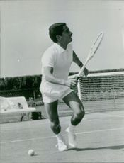 Yves Saint-Martin playing lawn tennis.