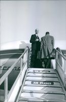 1964 Men boarding in the airplane...Air France..