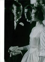 An exclusive photo of Princess Désirée & Baron Nils-August Otto Carl Niclas Silfverschiöld at their marriage ceremony at 1964.