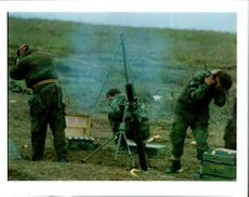 Rebel Bosnian Muslim forces fire a mortar.