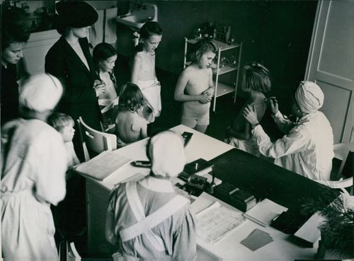 """""""Operation Stork."""" The medical examination of children leaving the first convoy of """"Operation Stork,"""" at the Wilmersdorf District Public Health Center."""
