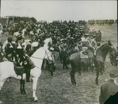 Horse riders with their horses gathered in a ground during a race. 1914