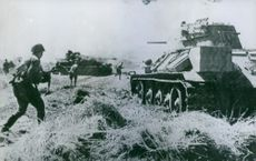 WW2. Soviet army advances north-east of Warsaw. T34 tank and Tiger tank