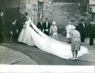 Katherine Worlsey happily waves her hand before walking her way to the altar on the day of her wedding to Prince Edward, Duke of Kent.  - Jun 1961