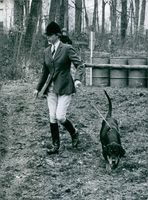 Princess Anne pictured at the Amberley Horse Show in Gloucestershire. She is exercising her new gun dog, an 18 months old Gascony hound called Baskerville which was given to her by Sir Rupert Buchanan-Jardine of Dumfriesshire.