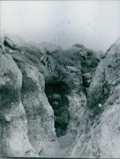Soldiers hiding in a cave during wartime.