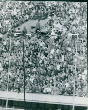 Man jumping pole during a high jump sport.