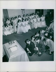 """People engaged in a ceremony.  """"__ USA __ of words  company"""" """"  1949"""