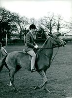 Prince Charles of Wales plays horse polo.