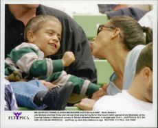 Boris Becker's wife Barbara plays with Noah during Boris match against Andre Medvedev in Melbourne