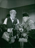 Carl Barcklind and Dagmar Ebbesen talking to each other during a scene from the film