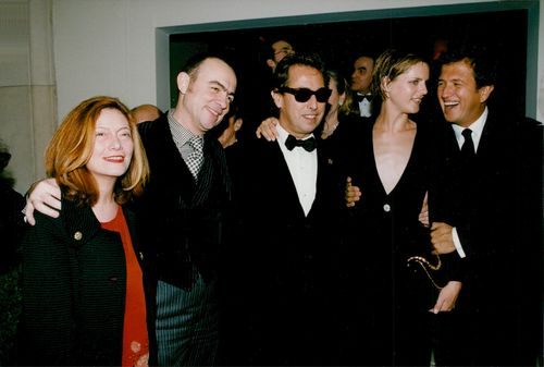 Christian Lacroix and his wife together with the star model Stella Tennant, surrounded by male friends.