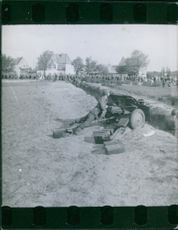 Soldier looking over cannon.