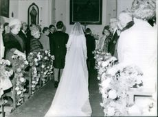 People gathered on a royal wedding in the church.