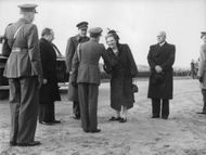 Juliana, Queen of the Kingdom of the Netherlands shaking hands with a Military Officer.