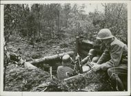 Soldiers Reloading the grenade launcher.