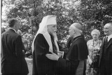 Church men shaking hands and talking to each other.  Taken - July 1967