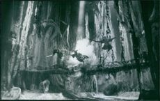Jack Tate as Yun, Don W. Lewis as Lai and Adrienne Corcoran as Tsun battle the evil warlord Komodo in MGM's live-action fantasy adventure Warriors of Virtue.