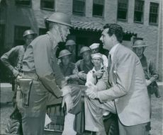1941  Cary Grant  an English actor who became an American citizen in 1942 assured members of the 151st infantry that he will do his bit in entertainments to raise funds for the United Service Organizations, proceeds to be used for recreational activities