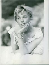 A photo of a French actress of the 1950s and the early 1960s Dany Robin contemplating.