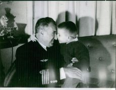 Dwight D. Eisenhower playing with his son.