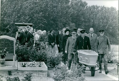 Paul Henri Spaak's inside the coffin, family and friends attended his burial.  - Aug 1972