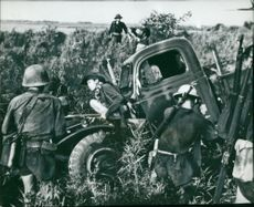 South Vietnam: Communists looting the shattered vehicle