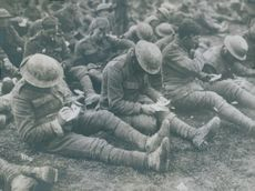 Soldiers writing something on paper during World War I, 1914.