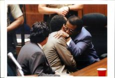 Defense Attorney Johnnie Cochran Jr., hugs his client OJ Simpson.