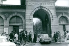 """Spectators outside """"Hopital de la Pitie"""" waiting for Christian Cabrol.  - May 1968"""