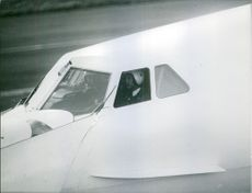A pilot of an airplane that is about to land. 1969