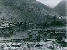The largest village in the monba country. All the houses are roofed with bamboo matting.The big whitewashed building on the left, which has a timber roof.