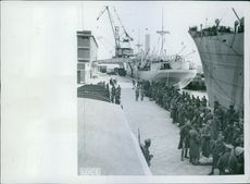 Englishmen, taken prisoners, on the North African front, are being kidnapped in a large Italian port for further transportation to prison camps.