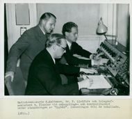 Radio Commissioner E. Mattsson, Dr. Lindfors and Telegraph Assistant R. Ölander at the switching and control table during the broadcast of