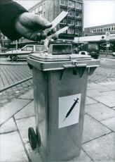 A container for drug addict's needles, at Hamburg Main Station - a notorious hangout for junkies. 1989.