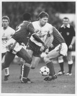 Clive Allen and Chris Fairclough are fighting for the ball