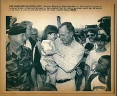 George Walker Bush with angela Hernandez.
