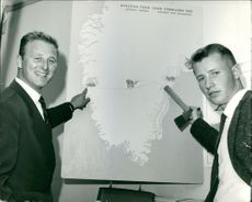 Two men showing a chart of Nansen's journey across Greenland.  Taken - 21 June 1962