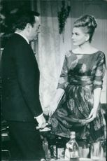 Eddie Constantine interacting with a woman.