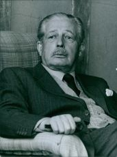 Portrait of Maurice Harold Macmillan in the summerhouse of his country home in Birch Grove.