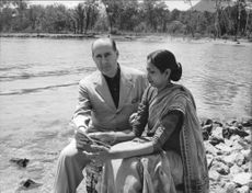 Roberto Rossellini enjoying free time with his wife on bank of Siagne river.