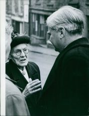 Aneurin Bevan stops to listen to the problems of an old age pensioner, one of the hundreds and thousands of old people who together pose one of Britain's most pitiful and urgent problems.