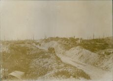 Soldiers moving through the raw road.