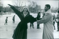 "Whitney Houston and Denzel Washington in a scene from ""The Preacher's Wife."""