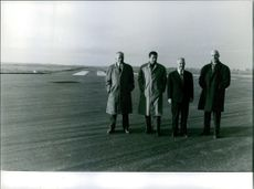 1961 Caravelle  Four men on their winter coat take a pose on the airport runway
