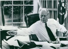 President Gerald R. Ford of America working in the Oval Office of the White House.  - 1974