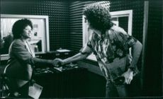 Robin Quivers and Howard Stern in the film Private Parts, 1997.