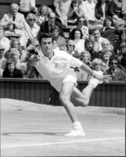 Ken Rosewall was in action during the match against John Newcombe in Wimbledon in 1974